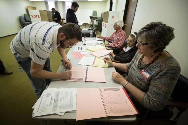 Sean Winget signs in after showing his driver's license to vote at Trinity Baptist Church on Super Tuesday March 1, 2016 in Oklahoma City. Oklahoma voters head to the polls for the 2016 Presidential Primary. (Photo by Brett Deering/Getty Images)
