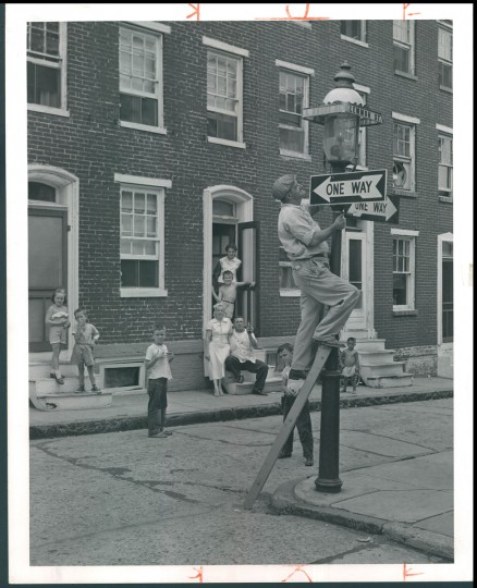 Bruce and Lemmon Streets in West Baltimore--Walter Lindman is the last lamp lighter with Welsbach 32 years. Photo dated August 4, 1957. (Bodine).