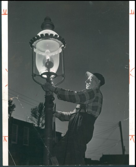 August 4, 1957 - THE VANISHING GAS LAMP -- Willie Hoffman, last gas street lamp lighter with 49-years of service. (Bodine).