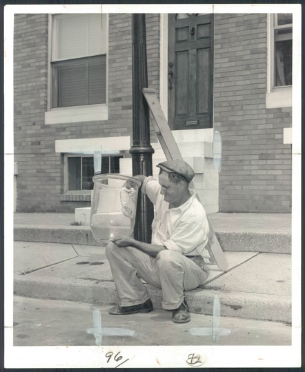 Walter Lindman cleans gas lamps for the last time in 1957. (Bodine).