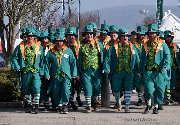 Racegoers dressed in fancy dress arrive at Cheltenham Racecourse in Cheltenham England on Thursday. Cheltenham always attracts a large number of Irish people to the Cheltenham Horse Racing Festival. (Joe Giddens/PA via AP)