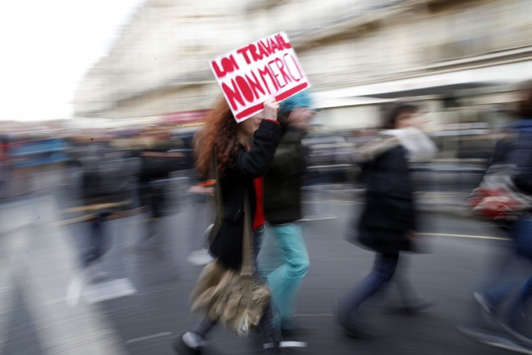 "A student holds a placard reading: ""Labour law. No Thanks"" during a protest in Paris, Wednesday, March 9, 2016. Angry unions and youth have entered a show of force with French President Francois Hollande in a day of protests against the government's effort to tamper with the country's 35-hour workweek to create new jobs. Several union and student organizations called protests across France on Wednesday to try to kill the bill which has even divided Hollande's Socialists. (AP Photo/Christophe Ena)"
