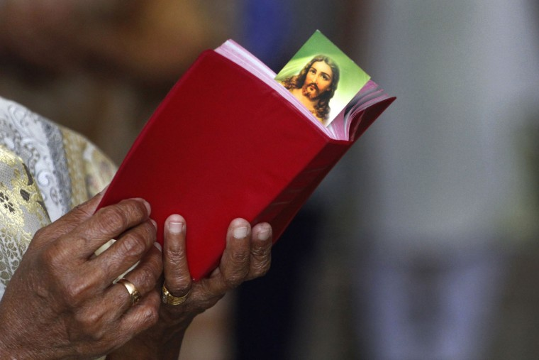 An Indian Christian prays at a church on Good Friday in Ahmadabad, India, Friday, March 25, 2016. Christians around the world are marking the death of Jesus Christ ahead of Easter Sunday. (AP Photo/Ajit Solanki)