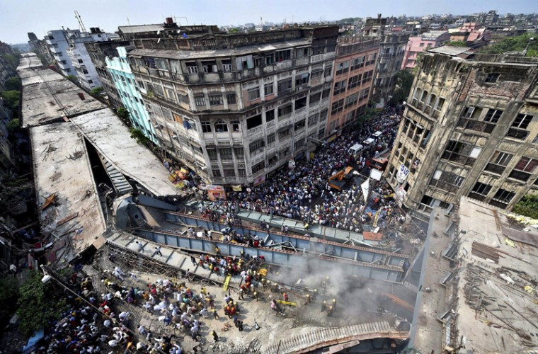 Locals and rescue workers clear the rubble of a partially collapsed overpass in Kolkata.(Swapan Mahapatra/Press Trust of India via AP)