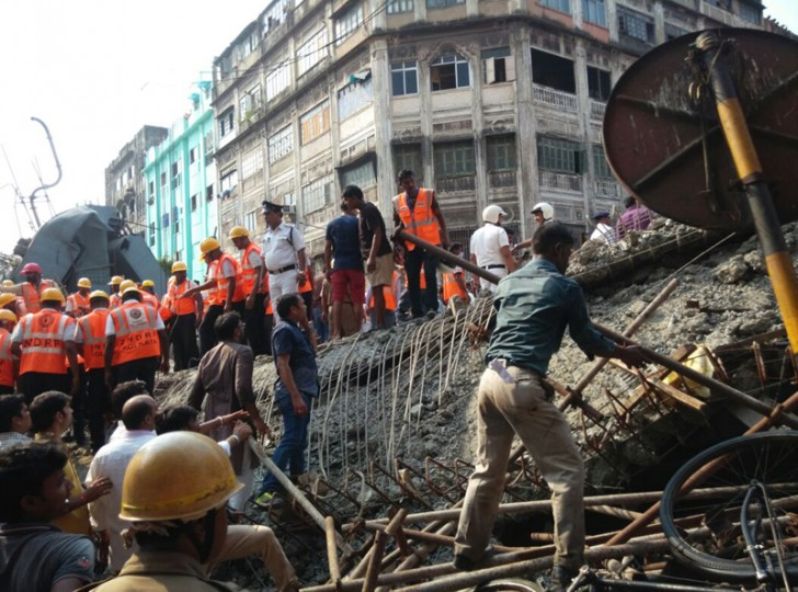 Locals and rescue workers clear the rubble of a partially collapsed overpass in Kolkata on Thursday. (Bikas Das/AP)