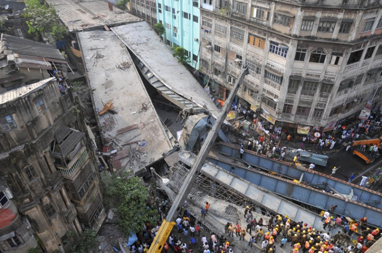 Locals and rescue workers clear the rubble of a partially collapsed overpass in Kolkata. (AP)