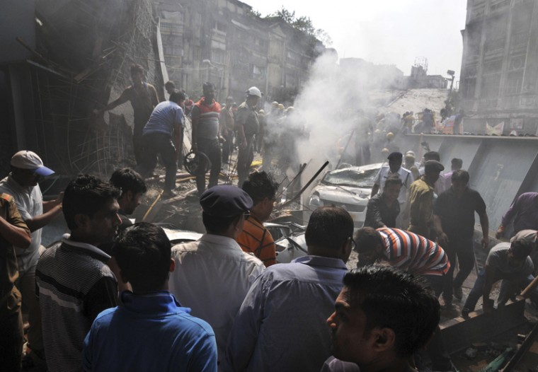Locals and rescue workers clear the rubble of a partially collapsed overpass in Kolkata on Thursday. (AP)