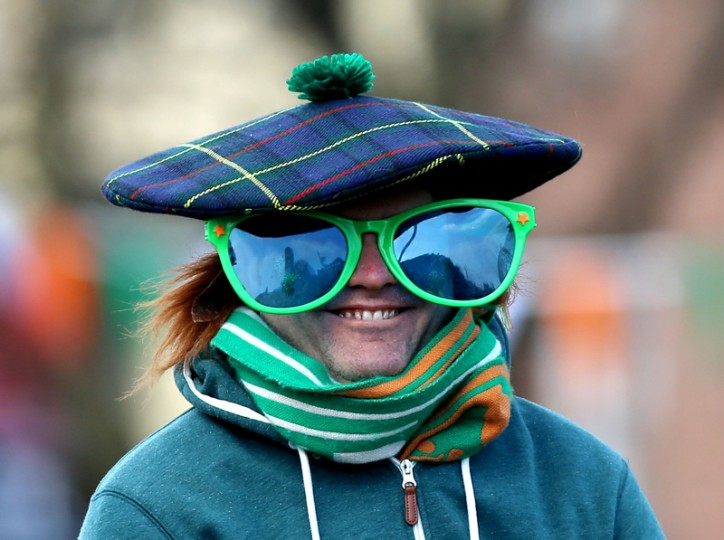 A spectator arrives to watch the St Patrick's Day parade on the streets of Dublin on Thursday. (Niall Carson/PA via AP)