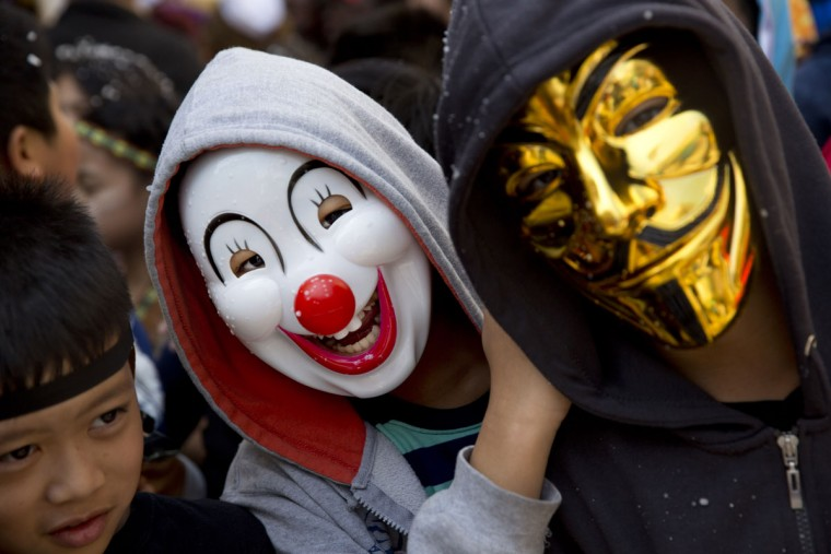 Foreign migrant workers children to celebrate the Purim festival in Tel Aviv, Israel, Tuesday, March 22, 2016. The Jewish holiday of Purim commemorates the Jews' salvation from genocide in ancient Persia, as recounted in the Book of Esther, which is read in synagogues. Other customs include: sending food parcels and giving charity; dressing up in masks and costumes; eating a festive meal; and public celebrations. (AP Photo/Ariel Schalit)