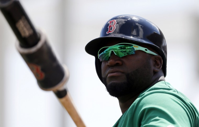 Boston Red Sox designated hitter David Ortiz, wearing green-tinted glasses, warms up as he stands on deck in the first inning of a spring training baseball game against the Baltimore Orioles on Thursday, in Fort Myers, Fla. The team wore green-themed uniforms in observance of St. Patrick's Day. (Tony Gutierrez/AP)