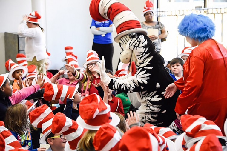 In this photo distributed by Feature Photo Service for NEA: The National Education Association's Read Across America Reading Tour lands this week in Dallas, Nashville, Phoenix, San Diego, Denver and Atlanta. The annual Read Across America Day is on March 2nd, the birthday of Dr. Seuss. (Kevin Lock/Feature Photo Service for NEA)