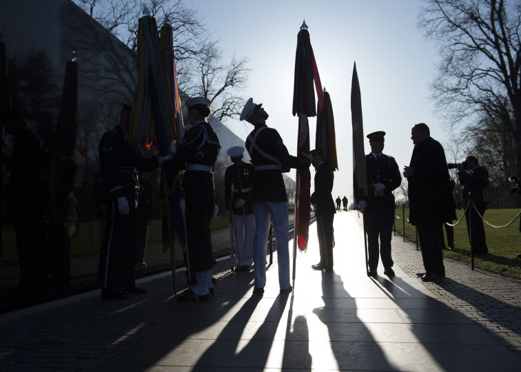 Color guard members arrive prior to a wreath laying ceremony to mark the 50th anniversary of the Vietnam War at the Vietnam Memorial Wall in Washington, Tuesday, March 29, 2016. (AP Photo/Molly Riley)