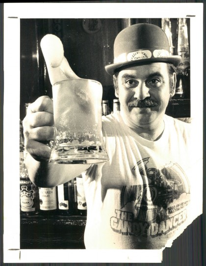 """""""Erin go slosh! With green suds flying, Noel Bautro toasts the advent of St. Patrick's Day among fellow Irish-at-least-for-a-week at the Gandy Dancer in the 1300 block McHenry Street."""" March 1979 (Swagger, The Baltimore Sun)."""