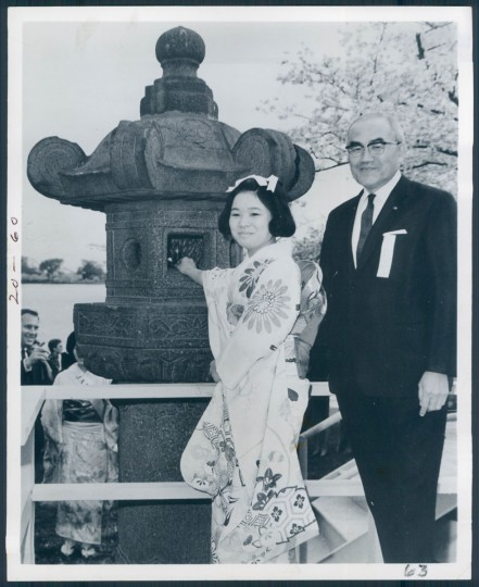 "The caption for this photo from March 20, 1969 says ""Each year a young woman from Japan lights the ancient stone lantern beside the Tidal Basin to officially open the National Cherry Blossom Festival."""