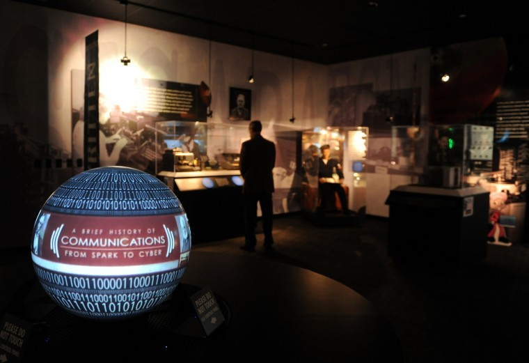 Steve Johnson of Fairhaven NJ looks at an exhibit of communications devices at the National Cryptologic Museum.  (Barbara Haddock Taylor/Baltimore Sun)