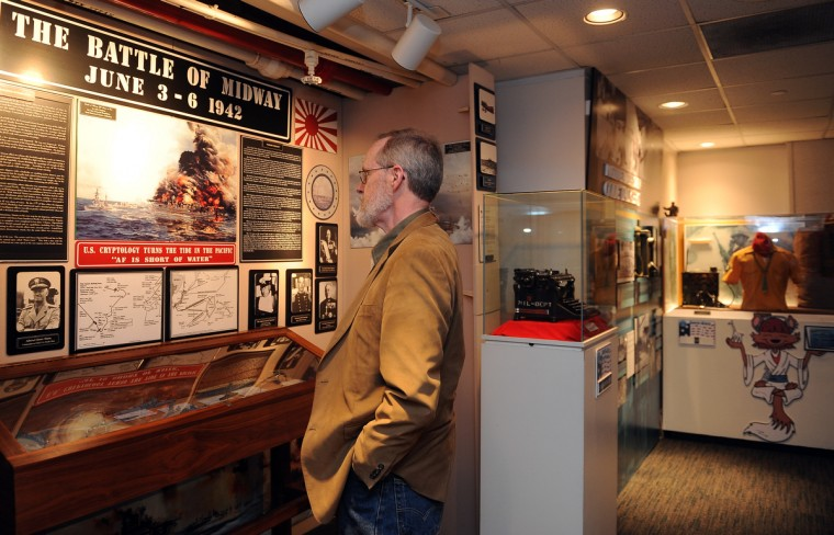Steve Johnson of Fairhaven, NJ, looks at an exhibit about the Battle of Midway at the National Cryptologic Museum.  (Barbara Haddock Taylor/Baltimore Sun)
