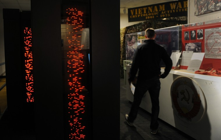 A man walks by the Frostburg Supercomputer, left,  at the National Cryptologic Museum.  (Barbara Haddock Taylor/Baltimore Sun)