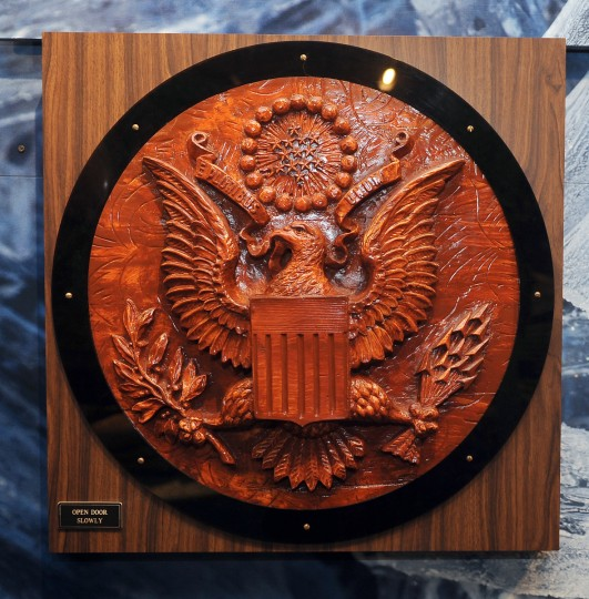 """A wood carving nicknamed """"The Thing"""" is a replica of the Great Seal of the United States that was presented by Soviet school children to the U.S. Ambassador in 1945.  The carving, which contained an undetected bugging device, hung in his residence in Moscow and recorded conversations until it was detected in 1952.  The replica is on display at the National Cryptologic Museum.  (Barbara Haddock Taylor/Baltimore Sun)"""