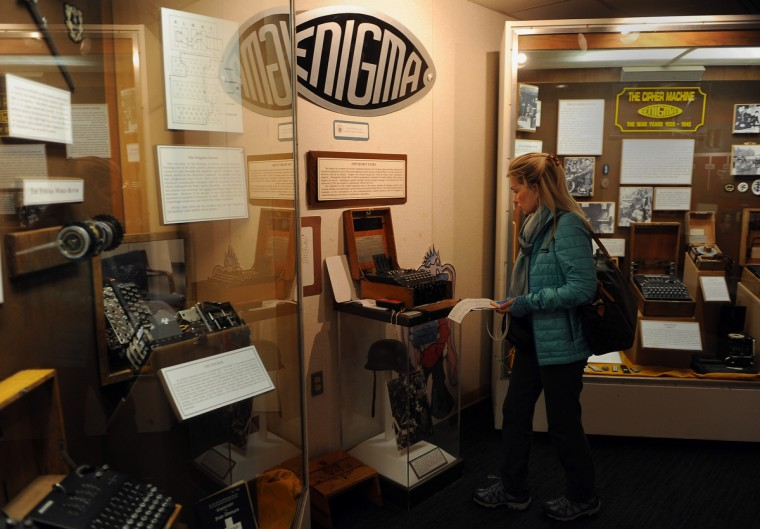 Kimberly Sauer of Warrenton VA looks at a display of Enigma cipher machines at the National Cryptologic Museum.  (Barbara Haddock Taylor/Baltimore Sun)