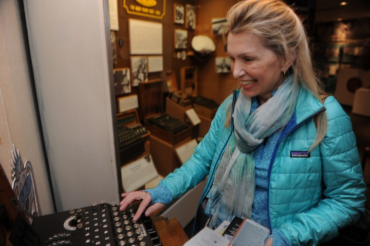 Kimberly Sauer of Warrenton, VA, tries out a real Enigma cipher machine at the National Cryptologic Museum.  (Barbara Haddock Taylor/Baltimore Sun)