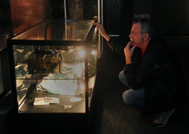Larry Will of Ontario, Canada, looks at Vietnam War-era communications equipment in a display case at the National Cryptologic Museum. He said he used identical equipment during his years in the Canadian Army Signal Corps.  (Barbara Haddock Taylor/Baltimore Sun)