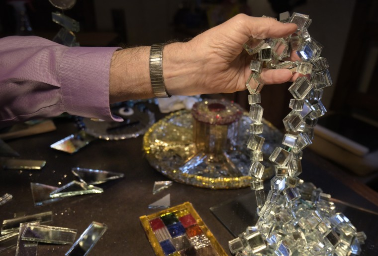 Mirror art comes in all shapes and sizes such as this  garland of one-inch-squares. (Algerina Perna/Baltimore Sun)