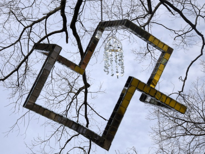 "In the foreground is the ""Star of David."" As it turns, one can see the star at one point; a rectangle at another, and 3 triangles at another. A mirrored wind chime hanging behind it is framed in the Star. (Algerina Perna/Baltimore Sun)"
