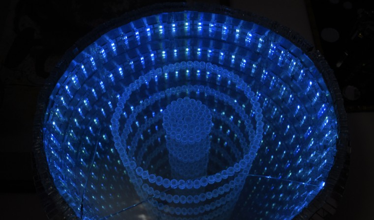 This infinity mirror  just one and one-half inches deep and made with a one-way mirror and a regular mirror with lights sandwiched in between creates the illusion of much greater depth. (Algerina Perna/Baltimore Sun)