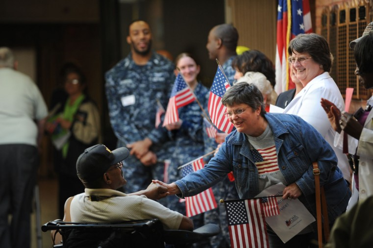 """Vietnam veteran Harvey Greene is greeted by Diane Milstead, a member of the Daughters of the American Revolution. A """"Welcome Home"""" parade and private ceremony is held at the Charlotte Hall Veterans Home. About 170 of the nearly 300 residents of this assisted-living facility are Vietnam vets. (Photo by Algerina Perna/Baltimore Sun Staff)"""