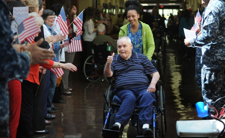 """Robert Davis, a Vietnam Veteran is greeted by members of the military; members of the DAR and others in the """"Welcome Home"""" parade and private ceremony held at the Charlotte Hall Veterans Home. This year marks hte 50th Anniversary of the Vietnam War. About 170 of the nearly 300 residents of this assisted-living facility are Vietnam Vets. (Photo by Algerina Perna/Baltimore Sun Staff)"""