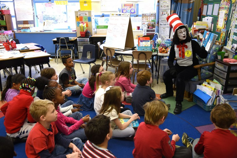 "The Cat in the Hat, filling in for second grade teacher Mrs. Lisa Ferrer, reads the Dr. Seuss book ""The Cat in the Hat"" to Ferrer's students at Hillsmere Elementary School. To celebrate Dr. Seuss's 112th birthday, schools and libraries across the country took part in the annual Read Across America Day, dressing like Seuss's characters and reading both is works and other favorite children's books."