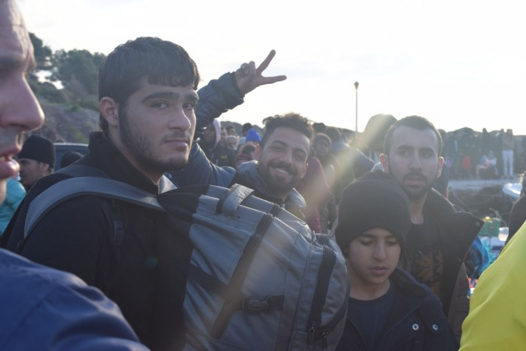 "When ships full of refugees came to shore, ""I would just start chatting with people,"" Harvey said. ""I always just made a point to learn their stories, what are they trying to do."" The photo above shows a group of young Kurdish men who arrived to Lesvos via ferry. Some of their fellow passengers had come all the way from Kobane, a city in Kurdish Syria that had been attacked by ISIS. (Ryan Harvey)"