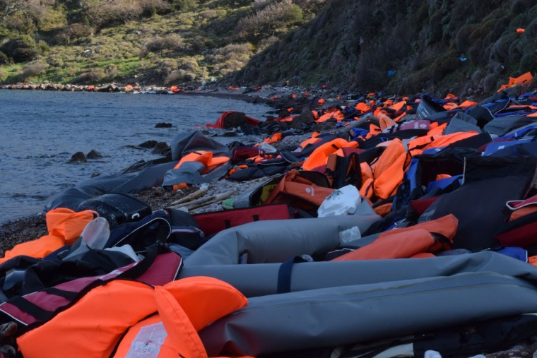 """Today, the sea around Lesvos is littered with abandoned boats, and the coast of Lesvos covered in life jackets. Many of them are counterfeit, says Harvey. """"A good life preserver is really thickly packed with foam,"""" says Harvey. """"You'd find ones where the inside was just a couple sheets of this crappy foam."""" Harvey says the CK Team has made an effort to inspect the factories in Turkey of life vest manufacturers to make sure they work well. (Ryan Harvey)"""