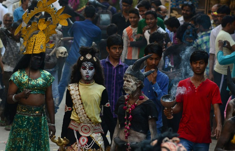 Indian artists dressed as Hindu deities take part in a religious procession to mark the Hindu festival of Maha Shivratri in Allahabad on March 7, 2016. Hindus mark the Maha Shivaratri festival by offering special prayers and fasting to worship the deity Shiva. (SANJAY KANOJIA/AFP/Getty Images)