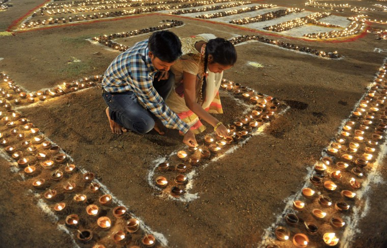 Indian devotees light diyas (earthen lamps) to honor Hindu deity Shiva during the Maha Shivaratri festival in Hyderabad on March 7, 2016. The festival of Maha Shivaratri is marked by Hindus by fasting and offering prayers in a night-long vigil. (NOAH SEELAM/AFP/Getty Images)