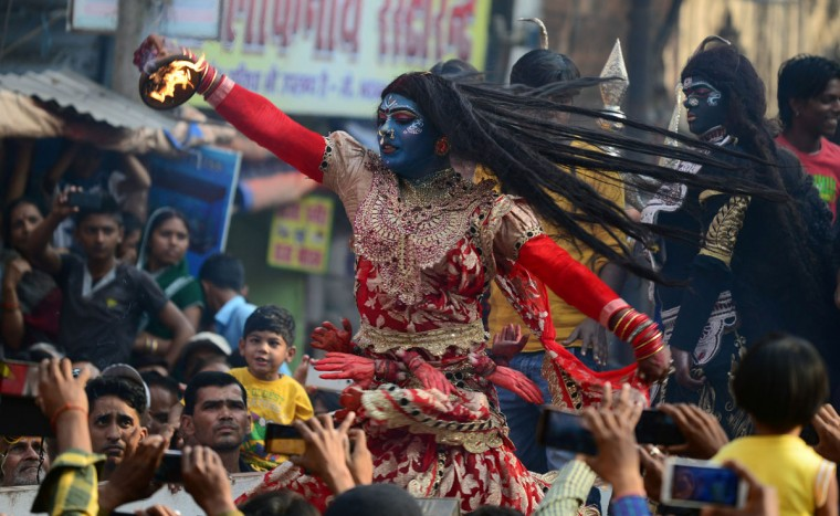 An Indian artist dressed as Hindu goddess Kali performs during a religious procession to mark the Hindu festival of Maha Shivratri in Allahabad on March 7, 2016. Hindus mark the Maha Shivaratri festival by offering special prayers and fasting to worship the deity Shiva. (SANJAY KANOJIA/AFP/Getty Images)