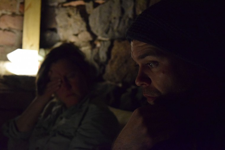 """Members of the CK Team, exhausted from the previous night's work, pull another nightshift at the Korakas lighthouse, where a 24-hour lookout monitors the ocean and members of our team slept prepared to coordinate transportation. If boats do land at the lighthouse, they are often smashed onto the rocks and people end up in the water. The Lighthouse Relief group would provide assistance on the beach here, and CK would handle transport."" (Ryan Harvey)"