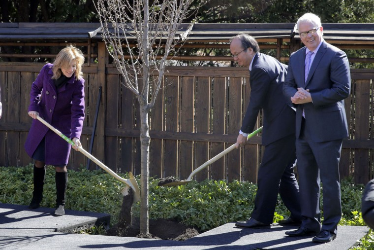 U.S. Ambassador to Japan Caroline Kennedy and Japanese Ambassador and Consul General of Japan in New York Reacher Takahashi, are joined by Brooklyn Botanic Garden President Scot Medbury, right, as they plant a ceremonial cherry tree, in New York, Tuesday, March 29, 2016. They were participating in ceremonies marking the 100th anniversary year of the Japanese Hill-and-Pond Garden. (AP Photo/Richard Drew)