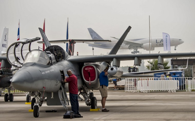 Ground crew members clean a US-built Scorpion attack aircraft exhibited at the international airport during the XIX Air and Space Fair (FIDAE) in Santiago on March 28, 2016. (MARTIN BERNETTI/AFP/Getty Images)