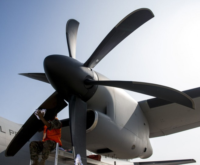 A ground crew member cleans a propeller of an aircraft's engine at the international airport during the XIX Air and Space Fair (FIDAE) in Santiago on March 28, 2016. (MARTIN BERNETTI/AFP/Getty Images)