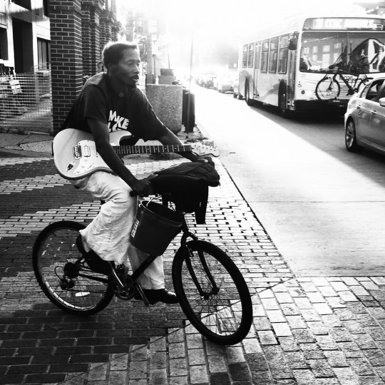 guitar-on-bike-bw-4x4-square