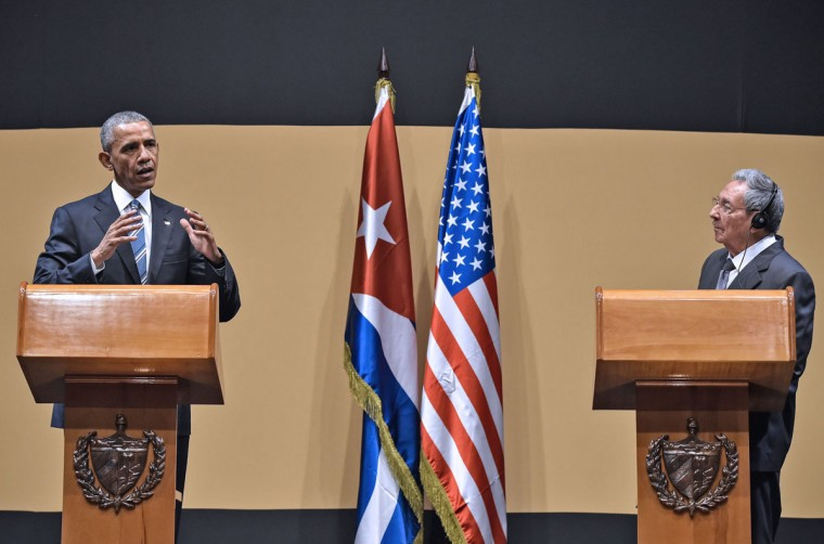 "US President Barack Obama and Cuban President Raul Castro give a joint press conference at the Revolution Palace in Havana on March 21, 2016. Cuba's Communist President Raul Castro on Monday stood next to Barack Obama and hailed his opposition to a long-standing economic ""blockade,"" but said it would need to end before ties are fully normalized. (NICHOLAS KAMM/AFP/Getty Images)"