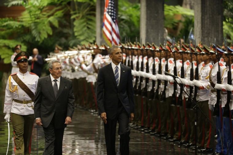Cuba's President Raul Casro, left, walks with U.S. President Barack Obama, as they inspect the guard in Revolution Palace, Monday, March 21, 2016. Brushing past profound differences, President Obama and President Castro sat down for a historic meeting, offering critical clues about whether Obama's sharp U-turn in policy will be fully reciprocated. (AP Photo/Ramon Espinosa)