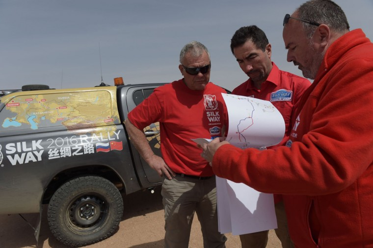 French race car driver Luc Alphand (second from right) and Silk Way Sports and Competitors Relationship Advisor talks with Silk Way course-setter Stephane Le Bail and Pilot Francois- Marcheix during an off-road mapping recognition exercise ahead of the Silk Way Rally 2016 in the Gobi Desert. (NICOLAS ASFOURI/AFP/Getty Images)