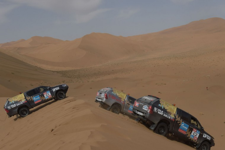 Cars drive over sand dunes during an off-road mapping recognition exercise ahead of the Silk Way Rally 2016 in the Gobi Desert. (NICOLAS ASFOURI/AFP/Getty Images)