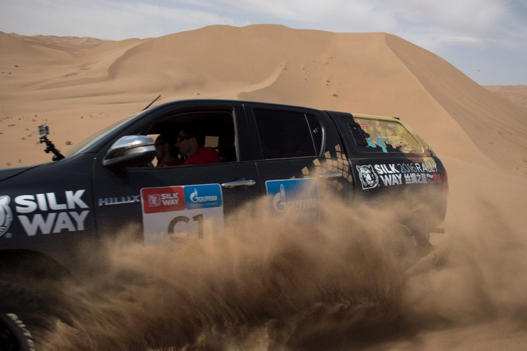 French former overall Ski World Cup winner and race car driver Luc Alphand drives his car over sand dunes during an off-road mapping recognition exercise ahead of the Silk Way Rally 2016 in the Gobi Desert. (NICOLAS ASFOURI/AFP/Getty Images)