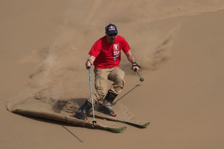 French former overall Ski World Cup winner and race car driver Luc Alphand skis sand dunes during an off-road mapping recognition exercise ahead of the Silk Way Rally 2016 in the Gobi Desert. (NICOLAS ASFOURI/AFP/Getty Images)