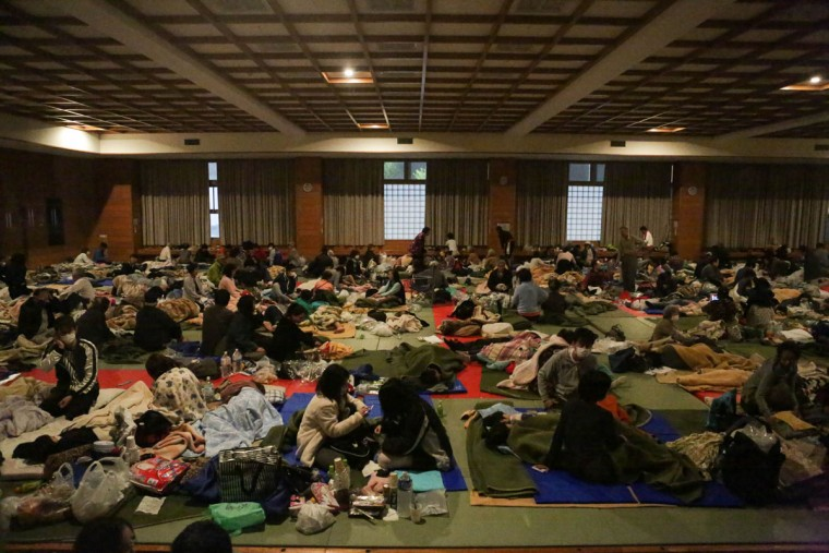 MASHIKI, JAPAN - APRIL 16: People get up right after the 7.3 magnitude earthquake at the evacuation center at the Mashiki Town Gymnasium on April 16, 2016 in Mashiki, Kumamoto, Japan. A 7.3 magnitude earthquake hit Kumamoto prefecture once again on April 16, 2016 after the 6.4 earthquake on April 14, 2016 killed nine people. (Photo by Taro Karibe/Getty Images)