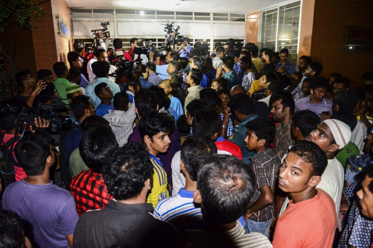 Bangladeshi journalists and onlookers gather in front of an apartment in Dhaka on April 25, 2016, where a leading gay rights activist was allegedly hacked to death. Two people including a leading gay rights activist were hacked to death at an apartment in the Bangladesh capital Dhaka, police said, the latest in a series of attacks on minorities in the Muslim-majority nation. (Munir uz Zaman/AFP/Getty Images)