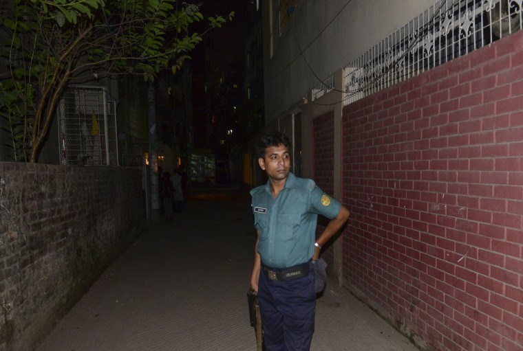 A Bangladeshi police official stands after in front of an apartment in Dhaka on April 25, 2016, where a leading gay rights activist was allegedly hacked to death. Two people including a leading gay rights activist were hacked to death at an apartment in the Bangladesh capital Dhaka, police said, the latest in a series of attacks on minorities in the Muslim-majority nation. (Munir uz Zaman/AFP/Getty Images)